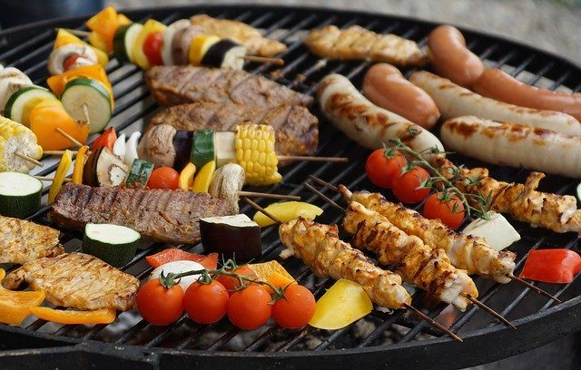Grilling different meats and sausages