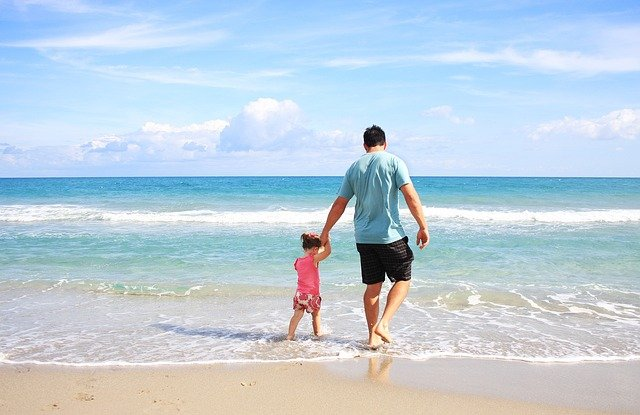 Father and child at the beach